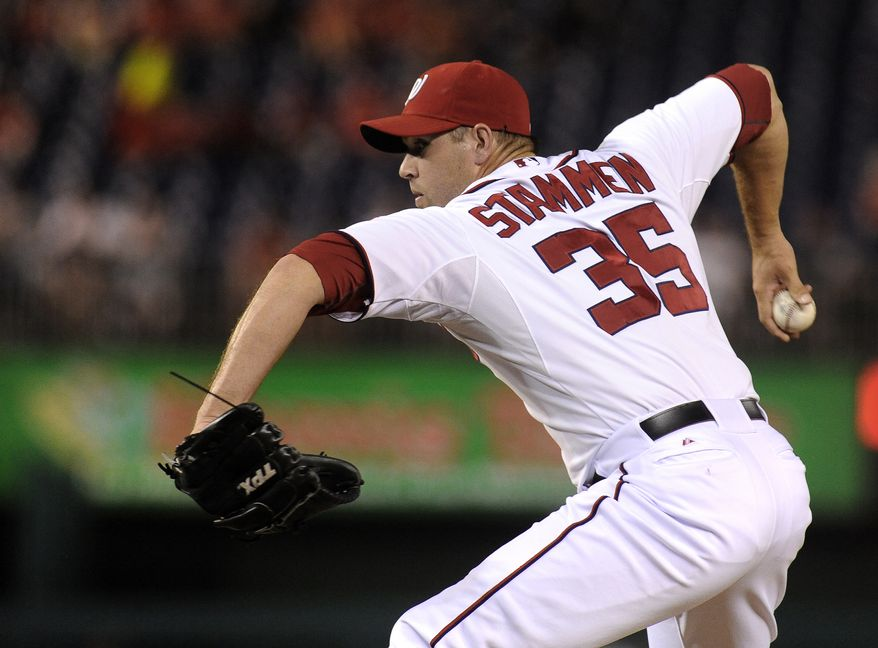 Washington Nationals' relief pitcher Craig Stammen pitches against the Chicago Cubs during their baseball game at Nationals Park, Wednesday, Sept. 5, 2012, in Washington. (AP Photo/Richard Lipski)