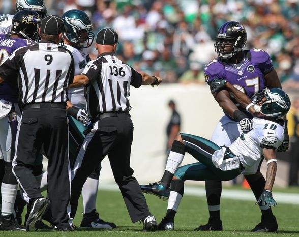 Philadelphia Eagles wide receiver DeSean Jackson is pulled away by Baltimore Ravens' Arthur Jones as Jackson and Raven's cornerback Cary Williams got into a scuffle during an NFL football game, Sunday, Sept. 16, 2012, in Philadelphia. (AP Photo/The Wilmington News-Journal, Suchat Pederson)  NO SALES