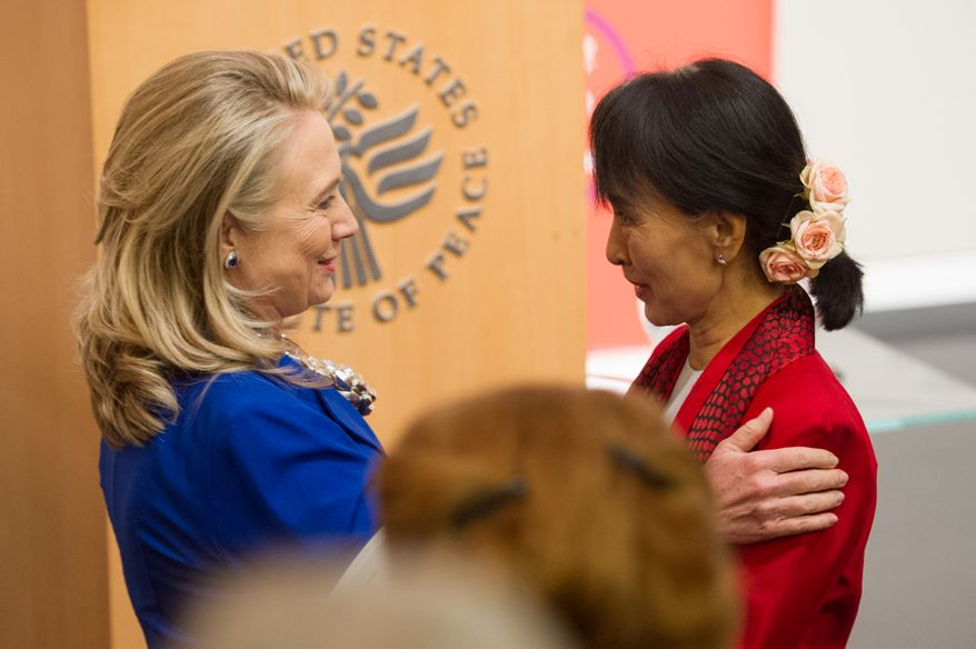 Secretary of State Hillary Rodham Clinton (left) greets Myanmar democracy leader Aung San Suu Kyi at the United States Institute of Peace in Washington on Tuesday, Sept. 18, 2012. (Andrew Harnik/The Washington Times)
