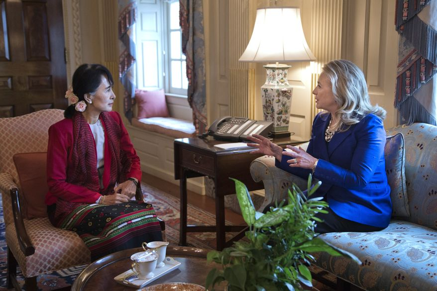 Secretary of State Hillary Rodham Clinton (right) meets with Myanmar democracy leader Aung San Suu Kyi at the State Department in Washington on Tuesday, Sept. 18, 2012. (AP Photo/ Evan Vucci)