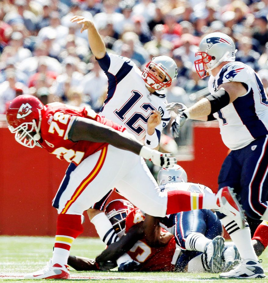 New England Patriots quarterback Tom Brady (12) has his leg buckled by Kansas City Chiefs safety Bernard Pollard, bottom, during the first quarter of an NFL football game at Gillette Stadium in Foxborough, Mass., Sunday, Sept. 7, 2008. Brady left the game and was taken to the locker room. (AP Photo/Winslow Townson)