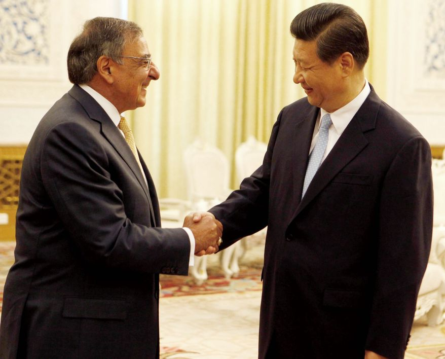 U.S. Defense Secretary Leon E. Panetta exchanges pleasantries Wednesday with Chinese Vice President Xi Jinping at the Great Hall of the People in Beijing. Mr. Xi is set to become Communist Party chief next month and president next spring. (Associated Press)
