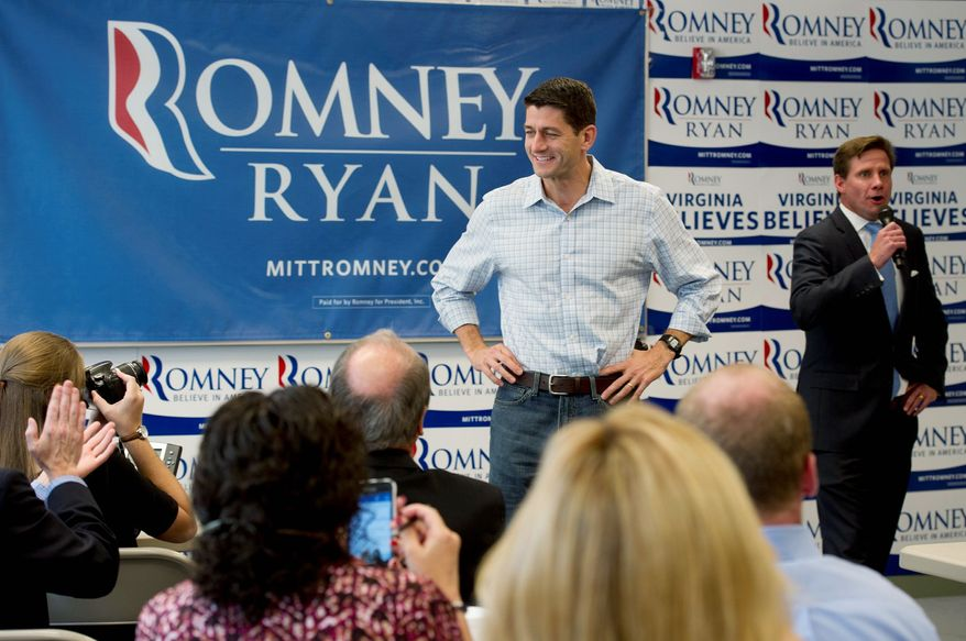 Backers take pictures of GOP vice presidential candidate Paul Ryan as he is introduced by Pete Snyder, coordinator for the Romney-Ryan campaign in the state of Virginia, at Romney-Ryan campaign headquarters in Arlington on Wednesday. Both camps are targeting Virginia. (Barbara L. Salisbury/The Washington Times)