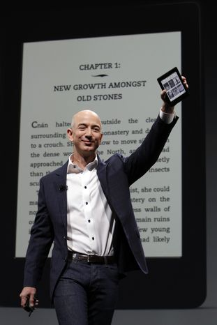 Jeff Bezos, CEO and founder of Amazon, at the introduction of the new Amazon Kindle Fire HD and Kindle Paperwhite personal devices, in Santa Monica, Calif., Thursday, Sept. 6, 2012. (AP Photo/Reed Saxon)