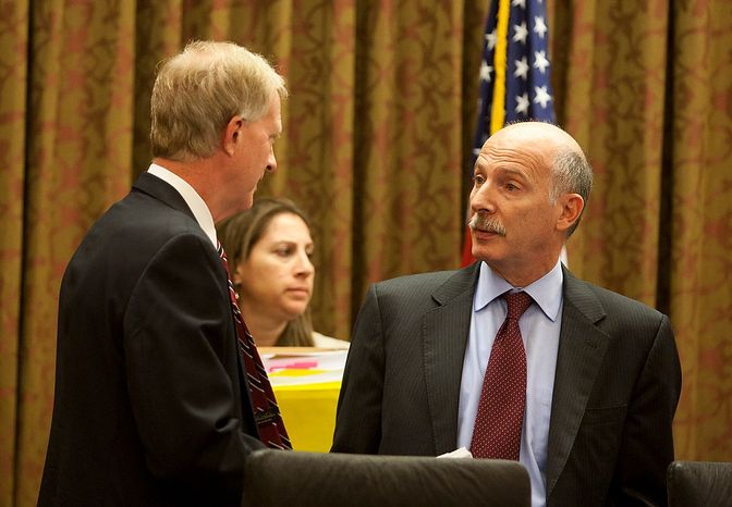 D.C. City Council Chairman, Phil Mendelson, (right) speaks with council member, Jack Evans, (left) before the first meeting after the summer recess, Wednesday, Sept. 19, 2012, in Washington, DC. (Craig Bisacre/The Washington Times)