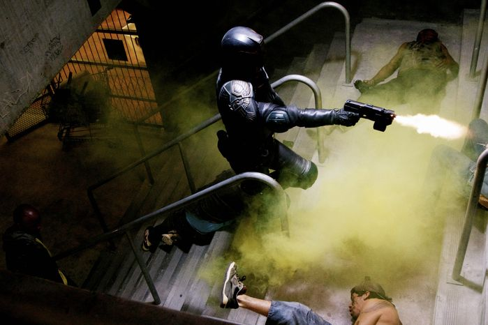 """This film image released by Lionsgate shows Karl Urban in a scene from """"Dredd 3D."""" (Associated Press/Lionsgate)"""