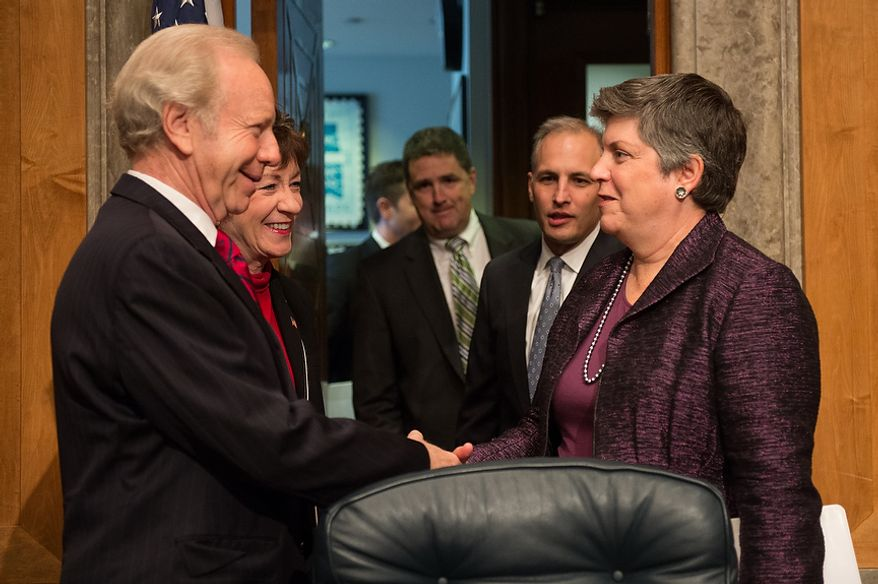 Sen. Joseph I. Lieberman (left) and Sen. Susan M. Collins (second from left) greet Homeland Security Secretary Janet A. Napolitano (right), FBI Associate Deputy Director Kevin Perkins (third from right) and National Counterterrorism Center Director Matthew G. Olsen (second from right) before they testify on homeland threats and agency responses before the Senate Homeland Security and Governmental Affairs Committee on Capitol Hill in Washington on Wednesday, Sept. 19, 2012. (Andrew Harnik/The Washington Times)