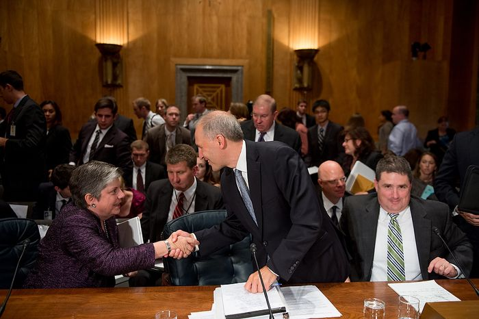 Homeland Security Secretary Janet A. Napolitano (left) shakes hands with National Counterterrorism Center Director Matthew G. Olsen (center) as they and FBI Associate Deputy Director Kevin Perkins (right) finish testifying on homeland threats and agency responses in front of the Senate Homeland Security and Governmental Affairs Committee on Capitol Hill in Washington on Wednesday, Sept. 19, 2012. (Andrew Harnik/The Washington Times)