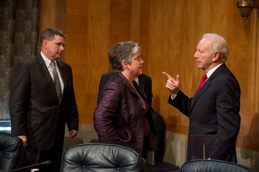 Homeland Security Secretary Janet A. Napolitano (center) speaks with Sen. Joseph I. Lieberman (right) following testimony on homeland threats and agency responses in front of the Homeland Security and Governmental Affairs Committee on Capitol Hill in Washington on Wednesday, Sept. 19, 2012. (Andrew Harnik/The Washington Times)