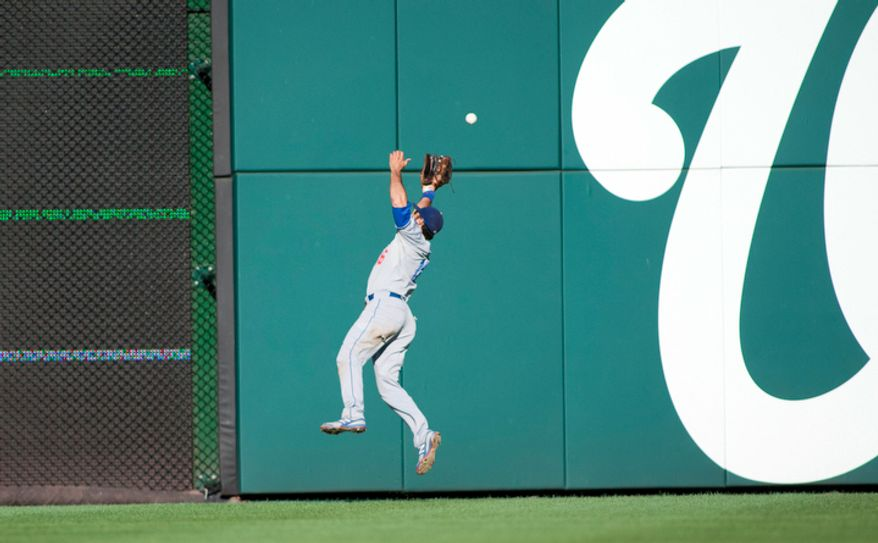 Los Angeles Dodgers right fielder Andre Ethier (16) misses a line drive to right, Wednesday, Sept. 19, 2012, in Washington, DC. Washington Nationals beat the Los Angeles Dodgers 3-1 in the first game of the doubleheader at National Park. (Craig Bisacre/The Washington Times)