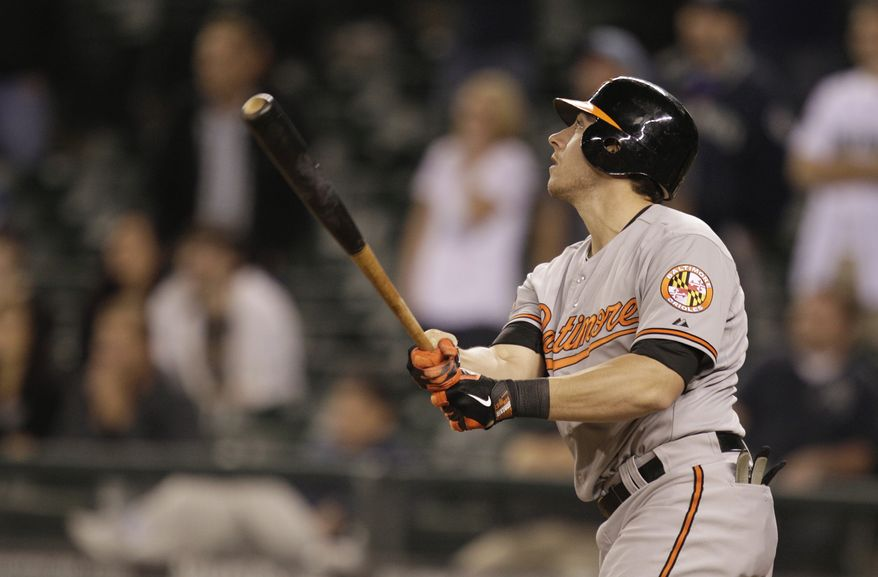 Baltimore Orioles' Taylor Teagarden hits a go-ahead RBI single in the 18th inning of a baseball game against the Seattle Mariners, in the early hours of Wednesday, Sept. 19, 2012, in Seattle. The Orioles beat the Mariners 4-2 in 18 innings. (AP Photo/Ted S. Warren)