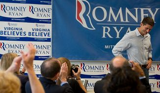 Northern Virginia campaign volunteers clap for Rep. Paul Ryan, the Republican vice presidential candidate, who stopped by the Romney-Ryan campaign headquarters in Arlington, Va. on Wednesday, Sept. 19, 2012. Mr. Ryan thanked the supporters for their hard work, noting that it is the personal connection of things such as their 100,000 phone calls that will make a difference in the campaign. (Barbara L. Salisbury/The Washington Times)