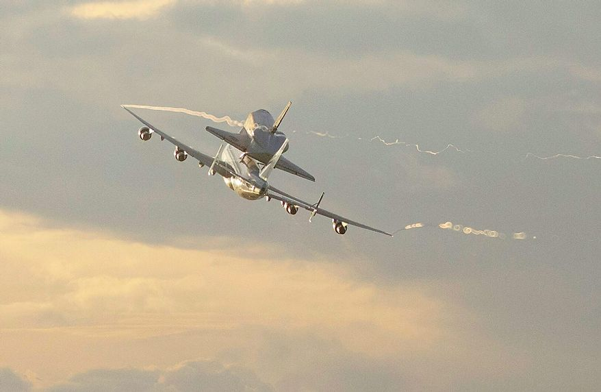 Space shuttle Endeavour makes its departure atop a modified jumbo jet from the Kennedy Space Center, Wednesday, Sept. 19, 2012, in Cape Canaveral, Fla. Endeavour will make a stop in Houston before heading to the California Science Center in Los Angeles. (AP Photo/John Raoux)