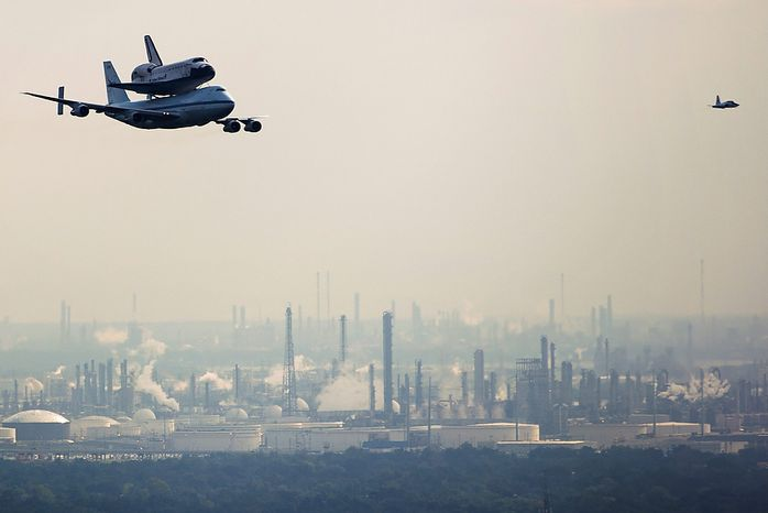 The space shuttle Endeavour, carried atop NASA's 747 Shuttle Carrier Aircraft, passes over petrochemical facilities on the Houston Ship Channel during a flyover on Wednesday, Sept. 19, 2012, in Houston. Endeavour stopped in Houston on its way from the Kennedy Space Center to the California Science Center in Los Angeles, where it will be placed on permanent display. (AP Photo/Houston Chronicle, Smiley N. Pool, Pool)