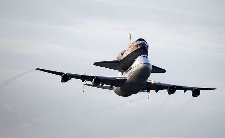 Space shuttle Endeavour atop a modified jumbo jet makes its departure from the Kennedy Space Center,  Wednesday, Sept. 19, 2012, in Cape Canaveral, Fla. Endeavour will make a stop in Houston before heading to the California Science Center in Los Angeles.(AP Photo/Terry Renna)