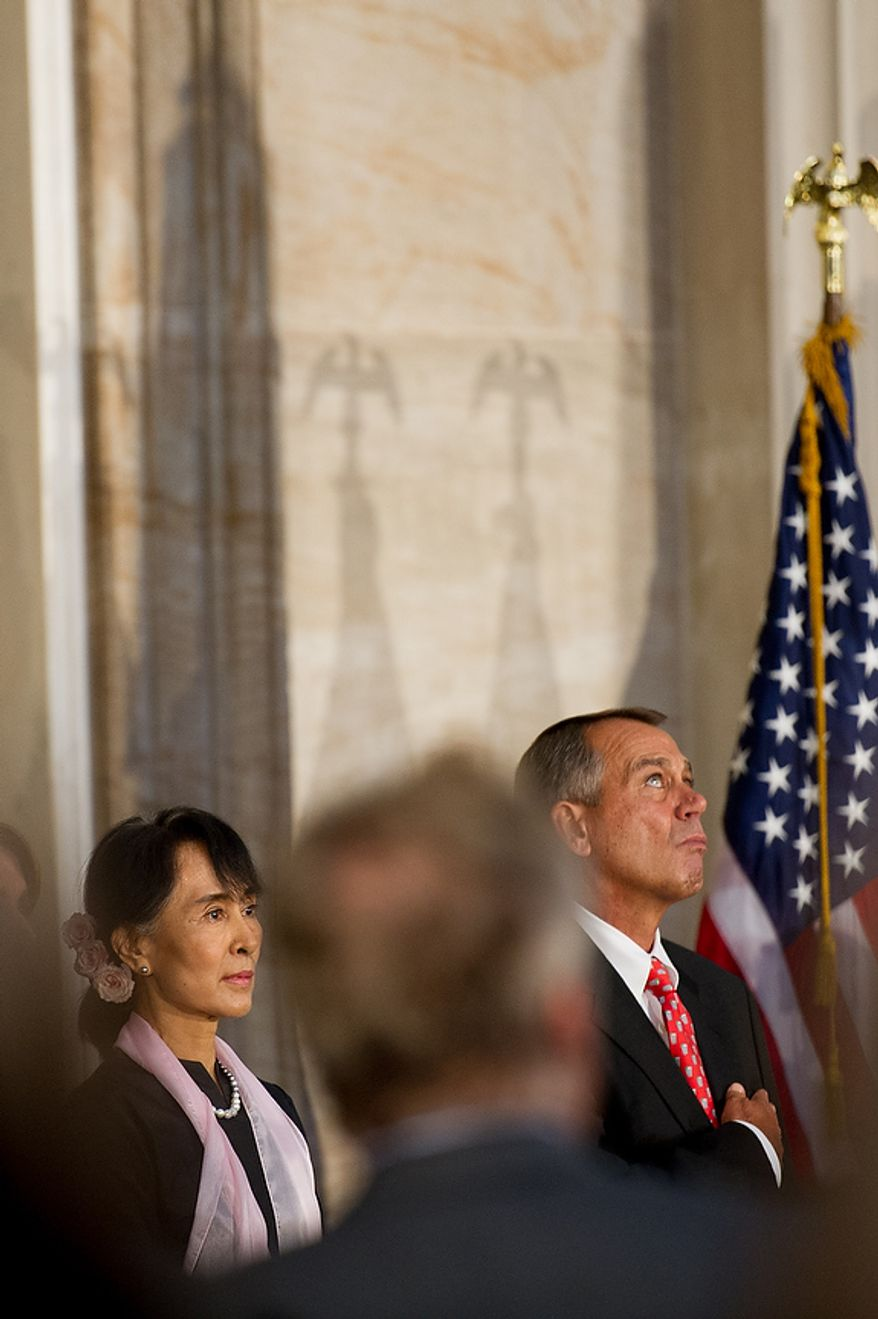 Chairperson and General Secretary of the National League for Democracy Aung San Suu Kyi of Myanmar, also known as Burma, left, stands next to Speaker of the House John Boehner (R-Ohio) during a ceremony to award Suu Kyi the Congressional Gold Medal  in the Capitol rotunda, Washington, D.C., Wednesday, September 19, 2012. (Andrew Harnik/The Washington Times)