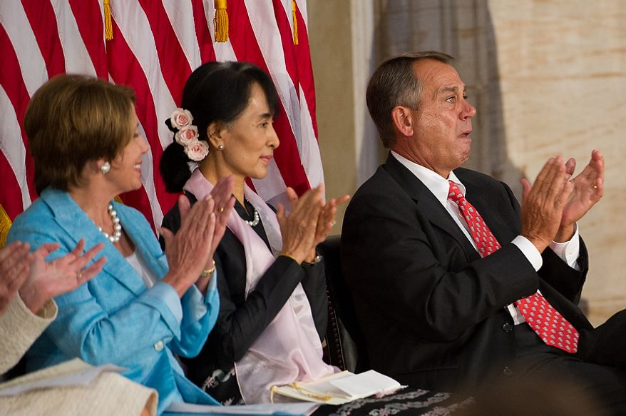 Chairperson and General Secretary of the National League for Democracy Aung San Suu Kyi of Myanmar, also known as Burma, center, sits between House Democratic Leader Nancy Pelosi (D-Calif.), left, and Speaker of the House John Boehner (R-Ohio), right, during a ceremony to award Suu Kyi the Congressional Gold Medal  in the Capitol rotunda, Washington, D.C., Wednesday, September 19, 2012. (Andrew Harnik/The Washington Times)
