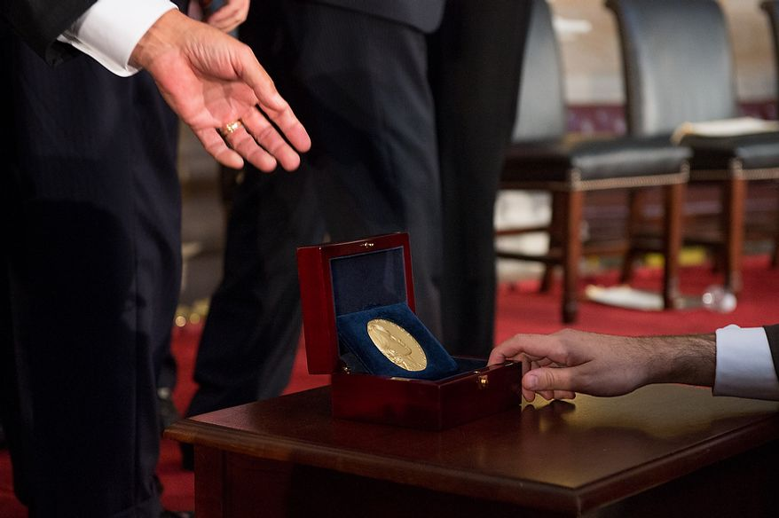Chairperson and General Secretary of the National League for Democracy Aung San Suu Kyi of Myanmar, also known as Burma, is awarded the Congressional Gold Medal, pictured, with Speaker of the House John Boehner (R-Ohio), Senate Majority Leader Harry Reid (D-Nev.), Senate Republican Leader Mitch McConnell (R-Ky.), House Democratic Leader Nancy Pelosi (D-Calif.), Secretary of State Hillary Rodham Clinton, and Former First Lady of the United States Laura Bush in the Capitol rotunda, Washington, D.C., Wednesday, September 19, 2012. (Andrew Harnik/The Washington Times)
