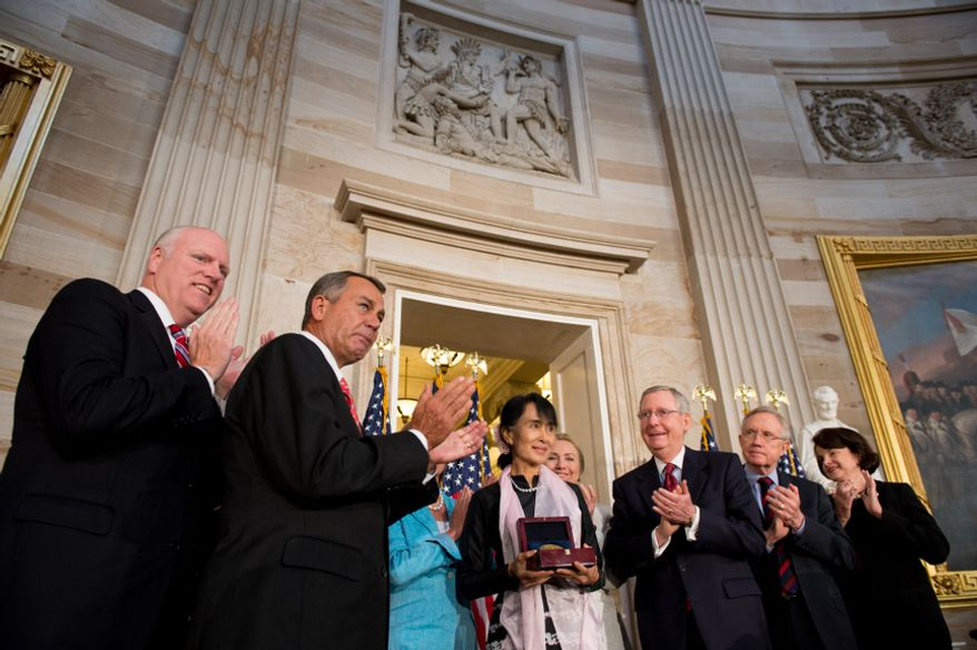 Myanmar opposition leader Aung San Suu Kyi (center) is awarded the Congressional Gold Medal in the Rotunda of the U.S. Capitol in Washington on Sept. 19, 2012. From left are Rep. Joseph Crowley, New York Democrat; Speaker of the House John Boehner, Ohio Republican; House Democratic Leader Nancy Pelosi; Suu Kyi; Secretary of State Hillary Rodham Clinton; Senate Republican Leader Mitch McConnell, Kentucky Republican; Senate Majority Leader Harry Reid, Nevada Democrat; and Sen. Dianne Feinstein, California Democrat. (Andrew Harnik/The Washington Times)