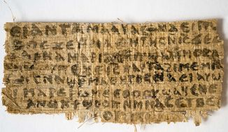 A fourth-century fragment of papyrus quotes Jesus explicitly referring to having a wife, Harvard Divinity School Professor Karen L. King says. (AP Photo/Harvard University, Karen L. King)