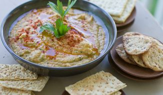Grilled zucchini hummus only takes about 20 minutes to make. It can be served immediately or chilled. It will thicken slightly as it chills. (Associated Press)