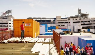 The Fairgrounds, a makeshift entertainment setup across from Nationals Park on Half Street, was one of the few options nearby for food and drink on Opening Day 2012. All that will be changing. By Opening Day 2013, 10 new restaurants and bars are expected to open. (Andrew Harnik/The Washington Times)