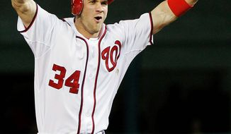 One reason the Nationals have improved by at least 10 games each year from 2010 through this season is that they have solidified positions in their lineup that once were question marks. Rookie Bryce Harper has done his share in the outfield since being called up April 28. (Associated Press)