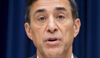 """Rep. Darrell E. Issa, chairman of the House Oversight Committee, says all 14 people named for sanctions or disciplinary action in a report on the gunrunning operation Fast and Furious """"should find new occupations."""" (Associated Press)"""