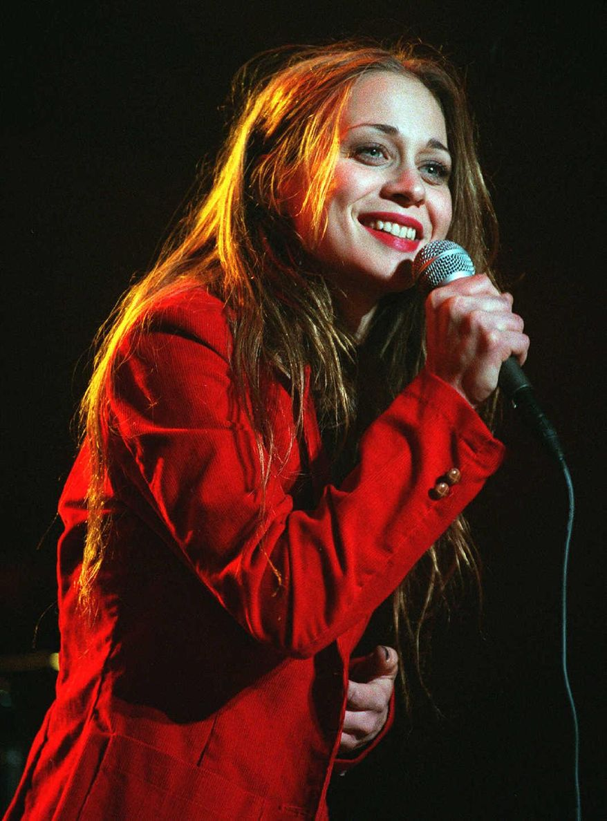 **FILE** Fiona Apple performs Dec. 11, 1999, at the annual KROQ Almost Acoustic Christmas concert at the Pond of Anaheim, Calif. (Associated Press)