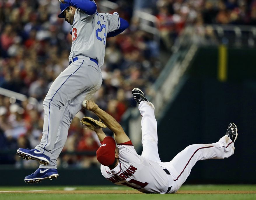 Ryan Zimmerman tagged Adrian Gonzalez for the third out in the fourth inning Wednesday. (Associated Press)