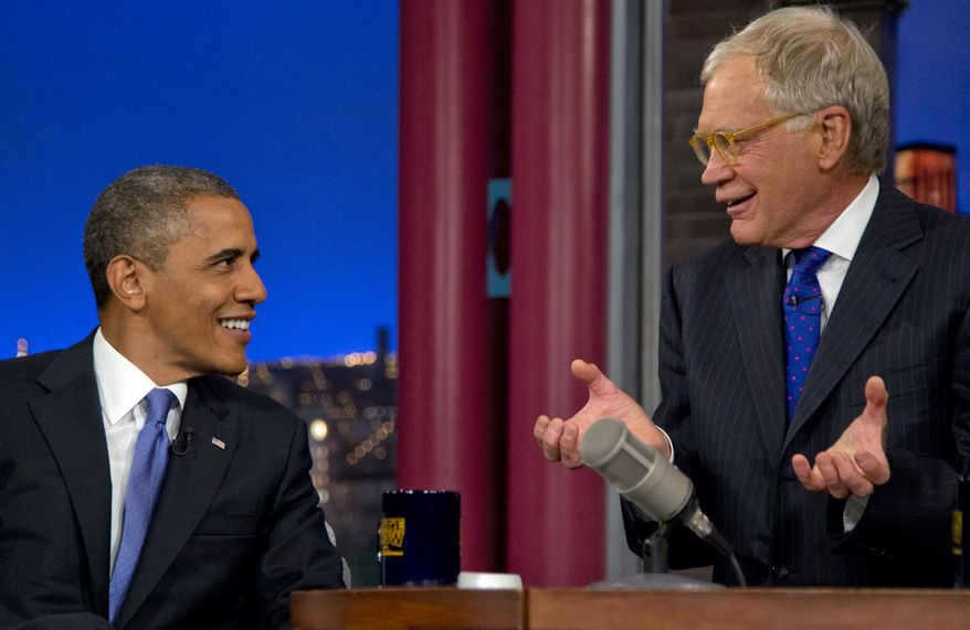 """President Obama talks with host David Letterman on the set of """"Late Show With David Letterman"""" at the Ed Sullivan Theater in New York on Tuesday, Sept. 18, 2012. (AP Photo/Carolyn Kaster)"""