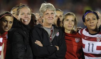 U.S. coach Pia Sundhage was overcome by emotion as a video tribute to her was played on the big screen following the game Wednesday night, Sept. 19, 2012. The United States women's soccer team defeated Australia 6-2 at Dicks Sports Good Stadium in Commerce City Wednesday.  It was the last game for coach Pia Sundhag   (AP Photo/Karl Gehring, The Denver Post)