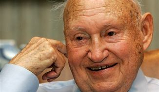 ** FILE ** In this July 26, 2006 photo, Chick-Fil-A founder Truett Cathy chuckles during an interview at his corporate headquarters office in Hapeville, Ga. (AP Photo/Ric Feld, File)