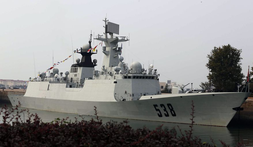 Chinese frigate Yantai is seen here in Qingdao, China, on Sept. 20, 2012. U.S. Defense Secretary Leon Panetta got a rare glimpse Thursday inside a Chinese naval base and toured two of its ships. Panetta checked out the frigate Yantai, which recently returned from a counter-piracy deployment in the Gulf of Aden, and the Great Wall 197, a conventionally powered submarine. (Associated Press)