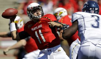 Maryland quarterback Perry Hills (11) throws to a receiver as he is pressured by Connecticut linebacker Sio Moore (3) during the first half of an NCAA college football game in College Park, Md., Saturday, Sept. 15, 2012. (AP Photo/Patrick Semansky)
