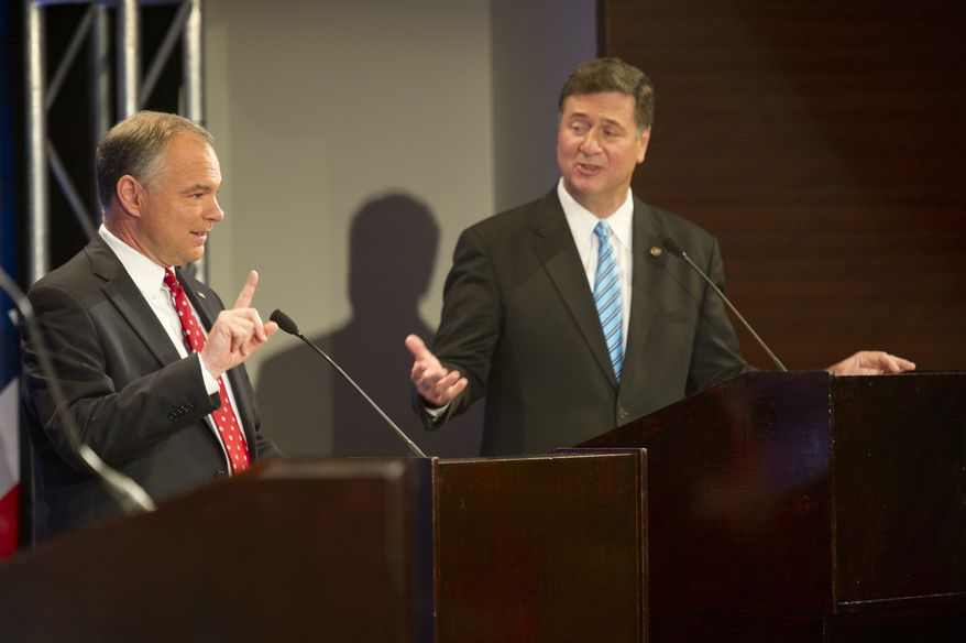 Tim Kaine, left, answers a question during the 2012 U.S. Senate Debate while his opponent George Allen looks on. The two men, who are both vying for the Virginia Senate seat, held their first of three debates on Thursday, Sept. 20, 2012 at the Capital One Conference Center in McLean, Va. (Barbara L. Salisbury/The Washington Times)
