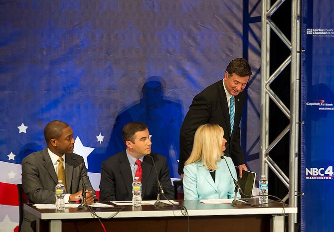 George Allen, former governor of Virginia, acknowledges the panelists for the 2012 U.S. Senate Debate, from left, Aaron Gilchrist from NBC4, Ben Pershing, a Washington Post reporter, and Julie Carey of NBC4, before taking the stage at the Capital One Conference Center in McLean, Va. on Thursday, Sept. 20, 2012. (Barbara L. Salisbury/The Washington Times)