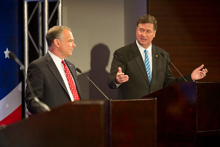 George Allen, right, looks at his opponent, Tim Kaine, while answering a question in the 2012 U.S. Senate Debate Thursday, Sept. 20, 2012 at the Capital One Conference Center in McLean, Va. The two men, who are both vying for the Virginia Senate seat, are locked in what has been called the most competitive race in the nation. (Barbara L. Salisbury/The Washington Times)