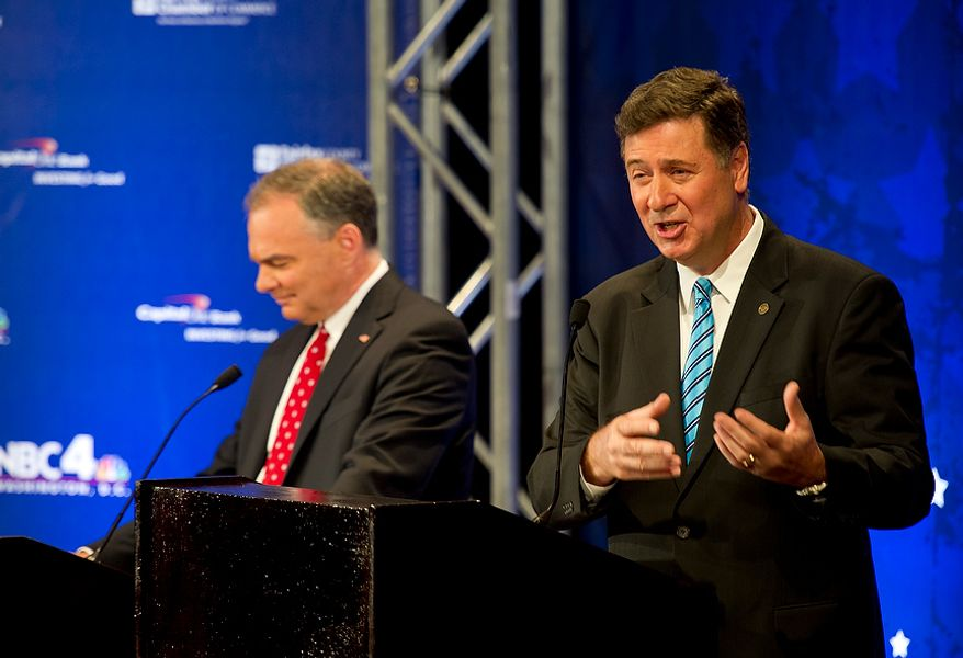 While Virginia Democratic U.S. Senate candidate Tim Kaine (left) makes notes, George Allen, his Republican opponent, answers questions in the first of three debates on Thursday, Sept. 20, 2012. The two former governors are vying for the seat being vacated by retiring Sen. Jim Webb. (Barbara L. Salisbury/The Washington Times)