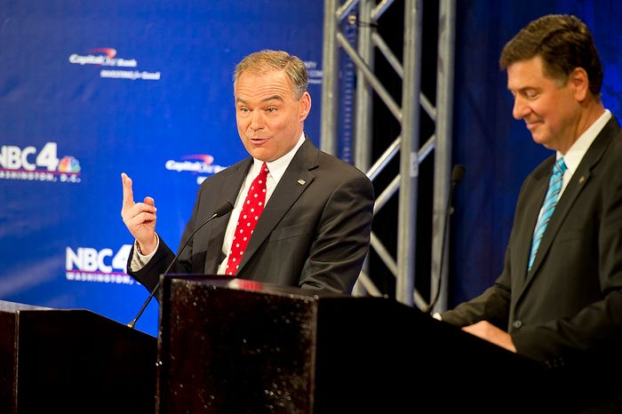 Tim Kaine, left, answers a question during the 2012 U.S. Senate Debate while his opponent George Allen looks down. The two men, who are both vying for the Virginia Senate seat, held their first of three debates on Thursday, Sept. 20, 2012 at the Capital One Conference Center in McLean, Va. (Barbara L. Salisbury/The Washington Times)