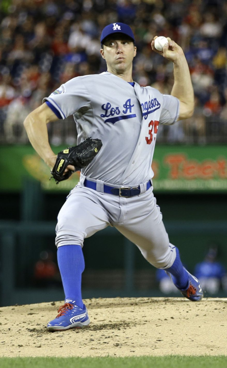 Los Angeles Dodgers starting pitcher Chris Capuano (35) throws a pitch against the Washington Nationals during the second inning of a baseball game at Nationals Park. (AP Photo/Jacquelyn Martin)