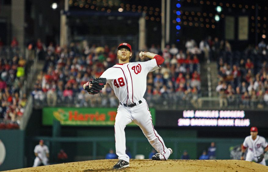 Washington Nationals starting pitcher Ross Detwiler (48) goes one, two, three in the first inning. (Craig Bisacre/The Washington Times)