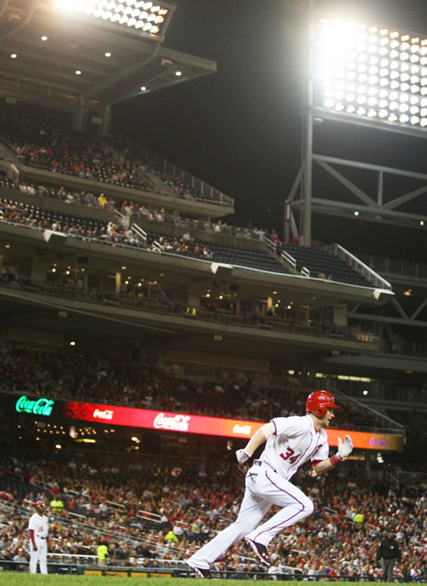 Washington Nationals center fielder Bryce Harper (34) hits a fielders choice single in the third inning against Los Angeles Dodgers at Nationals Park. (Craig Bisacre/The Washington Times)