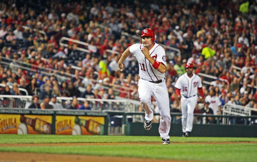 Washington Nationals third baseman Ryan Zimmerman (11) steals home in the third inning. (Craig Bisacre/The Washington Times)