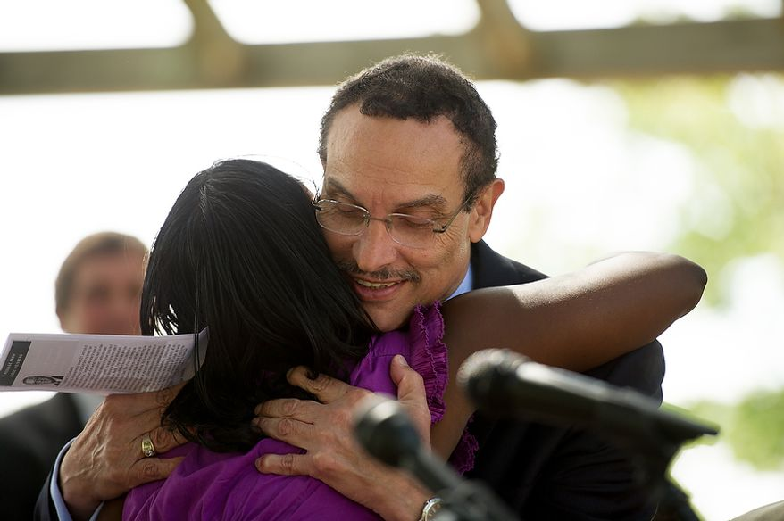 Kianna Brittingham gets a hug from Washington, D.C. Mayor Vincent Gray as she accepts her certificate during a graduation ceremony for a six month drug-addiction rehabilitation program held in Ft. Lincoln Park, Washington, D.C., Thursday, September 20, 2012. Participants still in the program along with friends and family cheered on the graduates and celebrated with a cookout. (Andrew Harnik/The Washington Times)