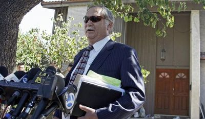 Lawyer Steve Seiden speaks to reporters outside a home believed to belong to the filmmaker associated with a crudely crafted anti-Muslim film that has caused controversy and violence throughout the Middle East and elsewhere, in the Los Angeles suburb of Cerritos, Calif., on Friday, Sept. 14, 2012. (AP Photo/Reed Saxon)