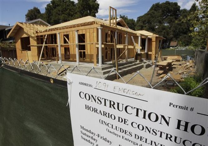 ** FILE ** In this Tuesday, Aug. 21, 2012, photo, a new home is under construction in Palo Alto, Calif. The average U.S. rate on the 30-year fixed mortgage held steady this week and remained slightly above the lowest level on record. (AP Photo/Paul Sakuma, File)