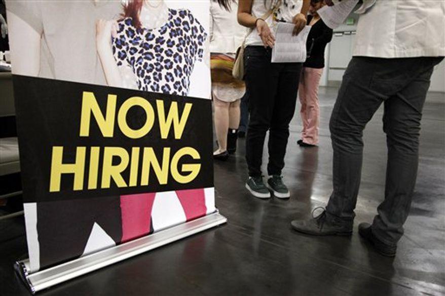 ** FILE ** In this June 13, 2012, file photo, a job seeker talks to a recruiter at a job fair expo in Anaheim, Calif. (AP Photo/Jae C. Hong, File)
