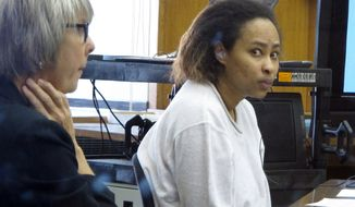 Annette Morales-Rodriguez (right) appears in a Milwaukee courtroom on Tuesday, Sept. 18, 2012, to face charges that she killed a pregnant woman and tried to steal her full-term fetus. Morales-Rodriguez's defense attorney, Debra Patterson (left), told jurors the homicides weren't intentional and her client never meant for the mother or baby to die. (AP Photo/Dinesh Ramde)
