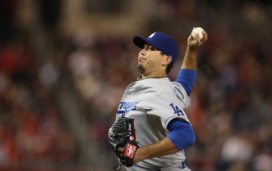 Los Angeles Dodgers starting pitcher Josh Beckett (61) goes eight inning giving up four runs, Wednesday, Sept. 19, 2012, in Washington, DC. Washington Nationals lose to the Los Angeles Dodgers 6 to 7 in the second game of the doubleheader at National Park (Craig Bisacre/The Washington Times)